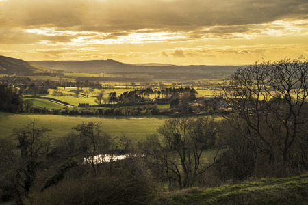 Stunning landscape image of sunset over countryside landscape in England