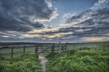 english countryside: Stunning English countryside landscape over fields at sunset Stock Photo