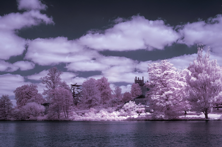 infra red: Stunning infra red alternative color landscape image of trees over river Stock Photo