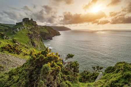 Beautiful sunset landscape image of Valley of The Rocks in Devon England