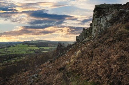 over the edge: Beautiful sunset over Curbar Edge in Peak District National Park