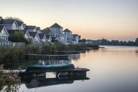 morning blue hour: Beautiful sunrise landscape image of clear sky over calm lake