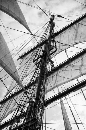 ship bow: Vintage picture of beautiful sail boat details. Rope, hull, rigging sailing yacht background