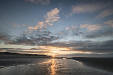 groynes: Beautiful beach coastal landscape image at sunrise with colorful vibrant sky