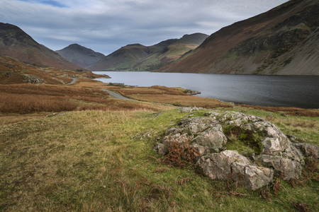 Stunning sunset landscape image of Wast Water and mountains in Lkae District in Autumn in England Stock Photo