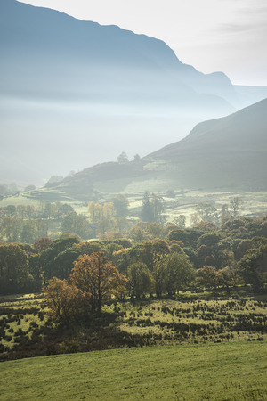 Stunning foggy Autumn Fall sunrise landscape image over countryside in Lake District in England