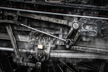 industrialised: Stunning grunge detailed close up of vintage steam train wheels and rods and mechanics