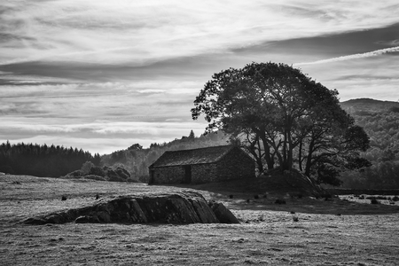 Beautiful black and white Autumn Fall landscape image of wide countryside in Lake District in England Stock Photo