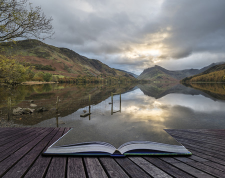 Stunning Autumn Fall landscape image of Lake Buttermere in Lake District England coming out of pages of book Stock Photo