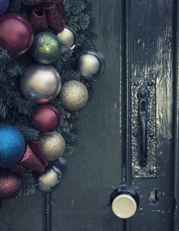 old fashioned christmas: Beautiful close up of old fashioned retro vintage style Christmas wreath hanging on wooden door Stock Photo