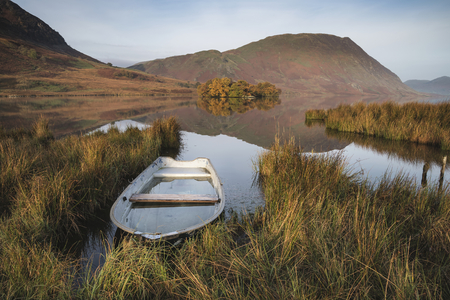cumbria: Stunning Autumn Fall landscape image of Crummock Water at sunrise in Lake District England Stock Photo