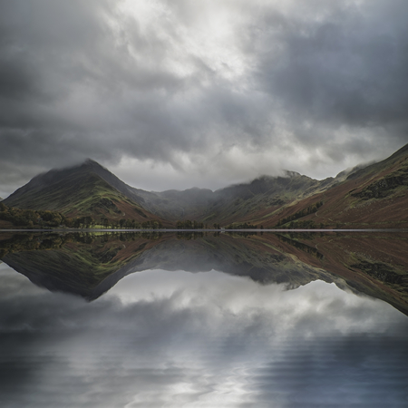 Stunning Autumn Fall landscape image of Lake Buttermere in Lake District England