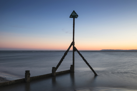 Beautiful Spring sunset long exposure beach landscape Stock Photo
