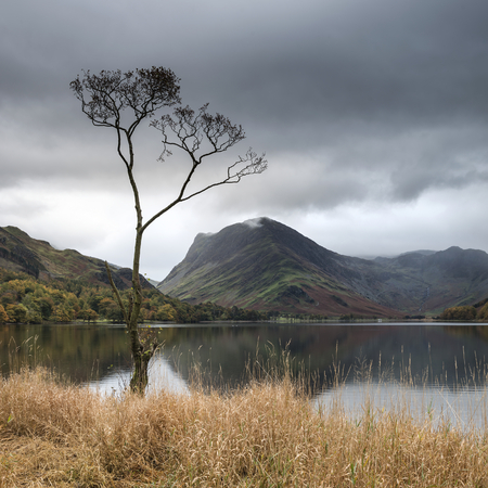 Beautiful Autumn Fall landscape image of Lake Buttermere in Lake District England