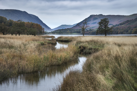 cumbria: Beautiful Autumn Fall landscape image of Lake Buttermere in Lake District England