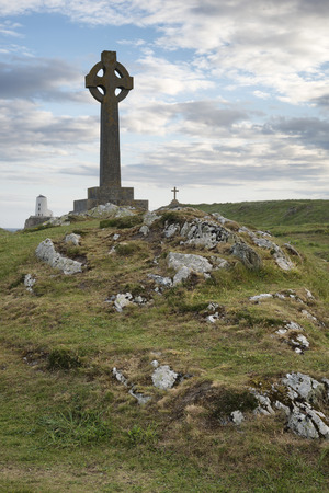 Celtic cross concept religion landscape in Ynys Llanddwyn Island in Anglesey Wales