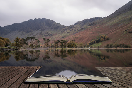 cumbria: Stunning Autumn Fall landscape image of Lake Buttermere in Lake District England  concept coming out of pages in open book Stock Photo