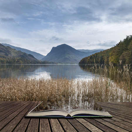 cumbria: Beautiful Autumn Fall landscape image of Lake Buttermere in Lake District England concept coming out of pages in open book Stock Photo