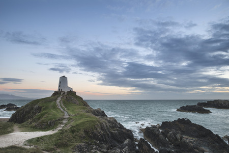 Beautiful Summer landscape image of lighthouse on end of headland with beautiful sky Stock Photo