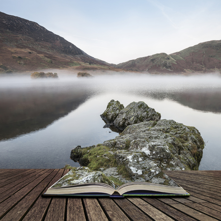 lake district: Beautiful Winter foggy sunrise on Crummock Water in Lake District England concept coming out of pages in open book