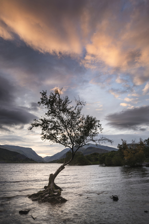 Beautiful landscape image of Llyn Padarn at sunrise in Snowfonia National Park Stock Photo