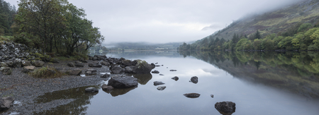 Landscape of Llyn Crafnant during foggy morning in Snowdonia National Park Stock Photo