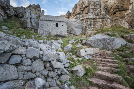Beautiful landscape image of St Govan's Chapel on Pemnrokeshire Coast in Wales Stock Photo