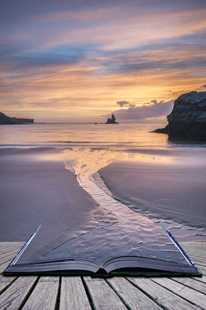 Stunning sunrise landsdcape of idyllic Broadhaven Bay beach on Pembrokeshire Coast in Wales in pages of imaginary story book Stock Photo