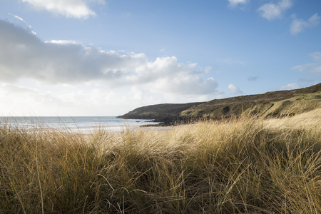 Beautiful landscape image of Freshwater West beach with sand dunes in Pembrokeshire Wales