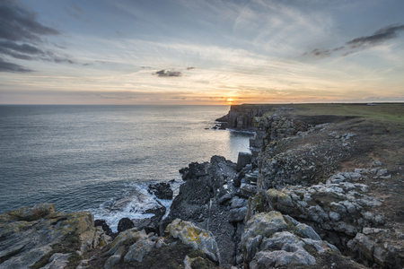 Beautiful landscape image of cliffs around St Govan's Head on Pembrokeshire Coast in Wales 스톡 콘텐츠