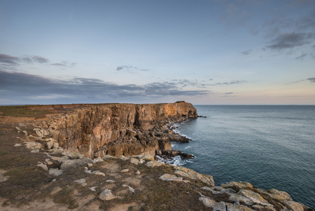 Beautiful landscape image of cliffs around St Govans Head on Pembrokeshire Coast in Wales
