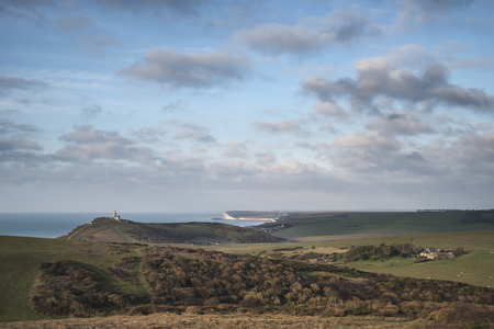 Beautiful landscape image of Belle Tout lighthouse on South Downs National Park during stormy sky