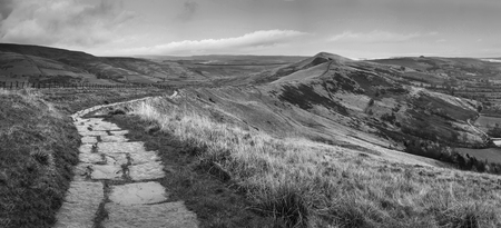 Black and white landscape of Mam Tor in Peak District during autumn.