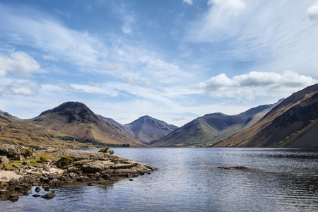 Lake District mountains landscape reflected in still lake of Wast Water Stok Fotoğraf