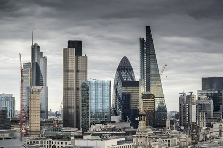 London cityscape skyline with iconic landmark buildings in The City with dramatic stormy sky