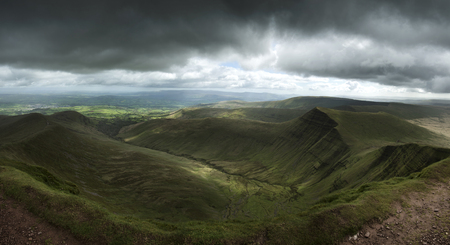 Landscape view from Pen y fan peak in Brecon Beacons with dark dramatic stormy sky Stock fotó