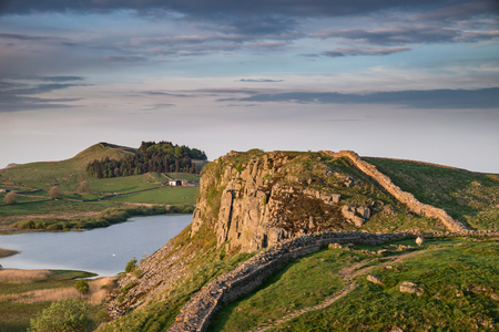 Stunning landscape image of Hadrian's Wall in Northumberland at sunset with fantastic late Spring light Stock Photo