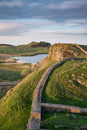 Stunning landscape image of Hadrian's Wall in Northumberland at sunset with fantastic late Spring light