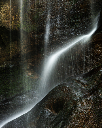 Stunning peaceful long exposure waterfall detail intimate landscape image Stock Photo