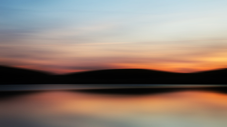 Blurred intentional camera movement effect filter vibrant landscape sunset