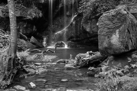 Stunning black and white waterfall landscape at Roughting Linn in Northumberland National Park in England