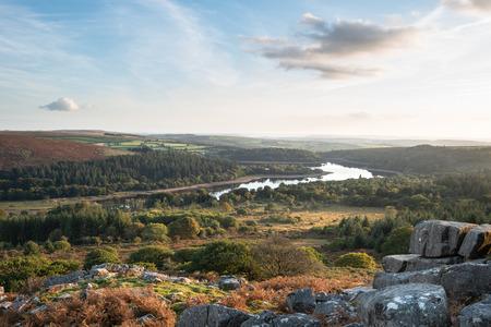 Beautiful Autumn sunset landscape image of view from Leather Tor towards Burrator Reservoir in Dartmoor National Park Banco de Imagens