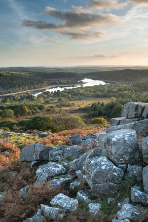 Beautiful Autumn sunset landscape image of view from Leather Tor towards Burrator Reservoir in Dartmoor National Park Banque d'images