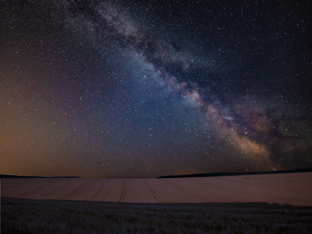 Stunning vibrant Milky Way composite image over landscape of wheat field in Summer 스톡 콘텐츠
