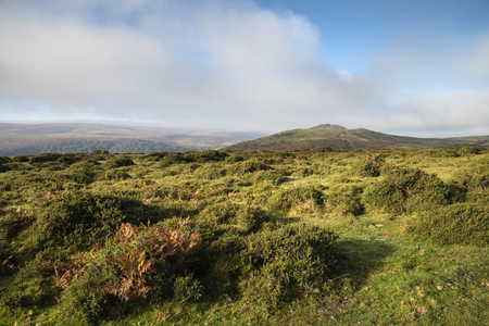 Beautiful lansdcape view across Dartmoor during misty Autumnal morning