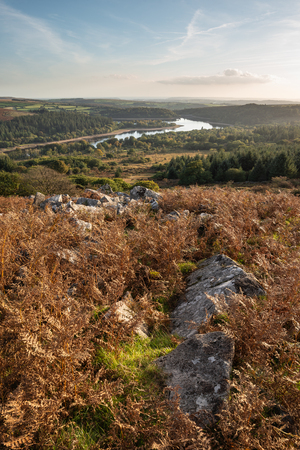 Beautiful Autumn sunset landscape image of view from Leather Tor towards Burrator Reservoir in Dartmoor National Park Banco de Imagens