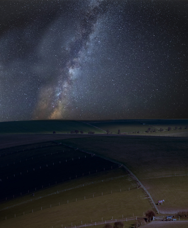 Stunning vibrant Milky Way composite image over landscape of countryside of rolling hills and valleys Archivio Fotografico