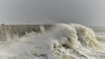 Stunning waves crashing over harbor wall during windy storm at Newhaven on English coast
