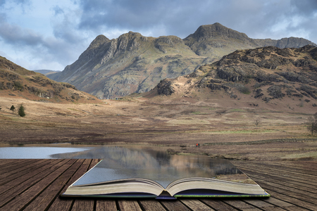 Stunning sunrise landscape image of Blea Tarn in UK Lake District coming out of pages in story book Stock Photo