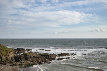 Beautiful late evening Spring landscape image of Ayrmer Cove on Devon coastline in England